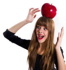 The pretty, young Girl and red apple. Isolated on white.