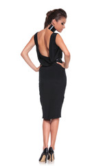 woman in a black dress with naked back