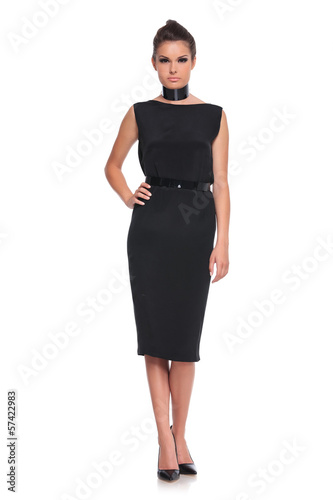 female fashion model in black dress and high heels shoes
