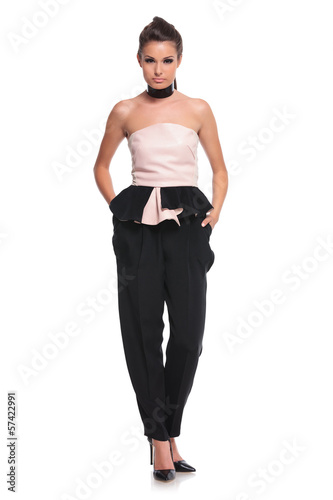 fashion woman posing with hands in pockets