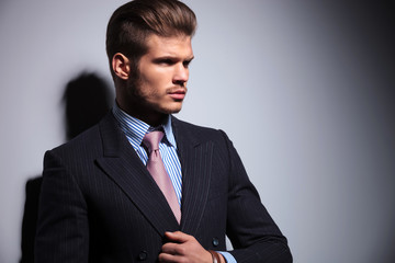side view of a sexy young man in classic suit and tie