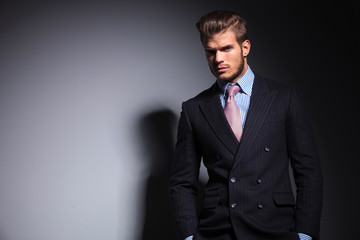 relaxed young fashion man in suit and tie