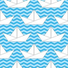 Seamless background with paper boats on the waves