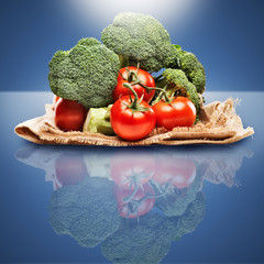healthy produce on blue background with light above.