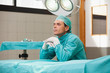 Surgeon sitting in an operating room
