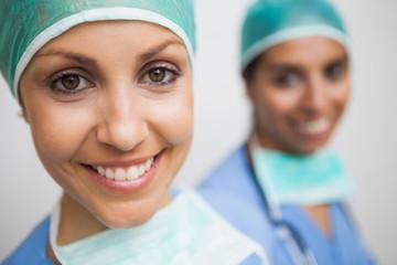 smiling nurse in surgical cap