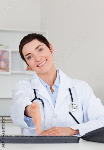 Female doctor giving her hand