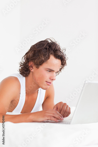 Portrait of a man using a laptop