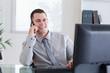 Happy businessman getting pleasant call
