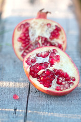 juicy pomegranate on the old wood board
