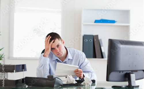 Businessman worried about invoice