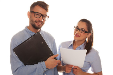 Nerdy couple holding files in a white background