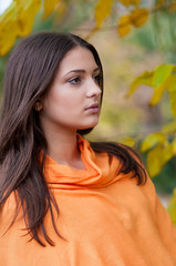 Young beautiful girl in autumn park