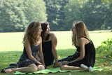 Three teenage girls enjoy a day at the park