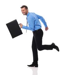 Happy businessman with briefcase running