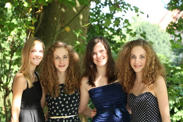 Group of attractive happy young teenage female friends