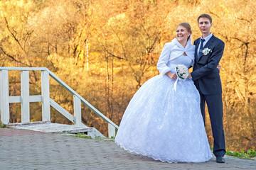 Groom ang bride on the promenade