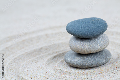 stone pyramid on sea sand