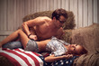 Sexy couple laying on the American flag