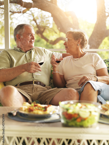 senior couple having dinner on patio