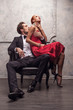 Elegant handsome man kissing his girlfriend in a shoulder