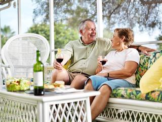 senior couple outside on patio relaxing