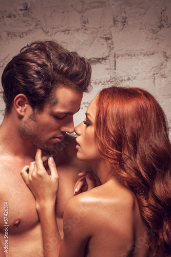 Close up of sexy nude couple going to kiss.