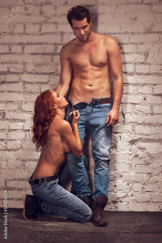 Handsome male model posing with beautiful girl on sexy shoot.