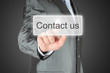 Businessman pushes virtual contact us button