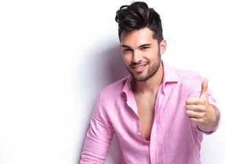 young fashion man shows thumb up