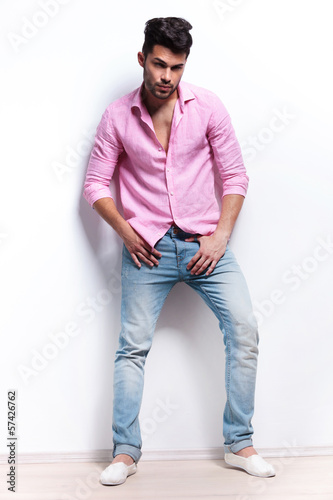 young fashion man with hands at crotch
