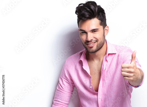 young fashion man shows thumb up