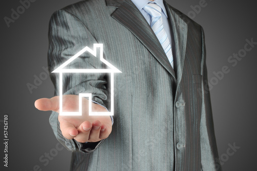 Virtual house with man on dark background .