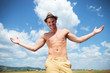 topless man outdoor looks at you with arms wide open