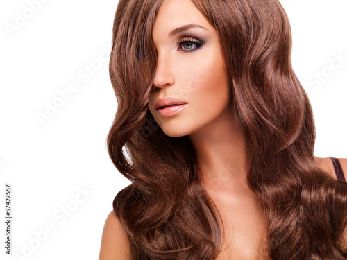 Profile portrait  of beautiful woman with long red hairs