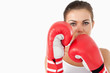 Female boxer taking cover behind her fists