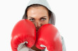 Female boxer with hoodie on taking cover