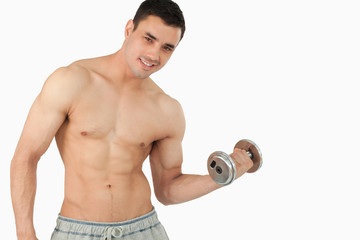 Young man lifting weight