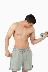 Young male doing weight lifting