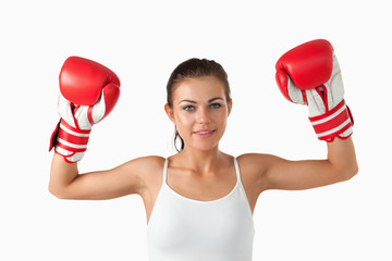 Female boxer raising her arms