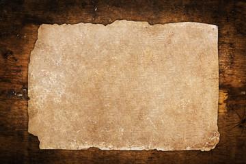 Vintage paper sheet on wood