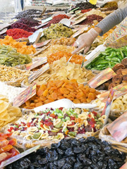 counter of colorful dried fruit