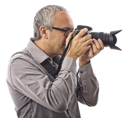 Professional photographer with camera on white