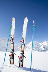 Ski, mountains and ski equipments on ski run