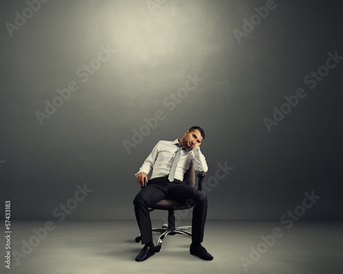 bored businessman sitting in the room
