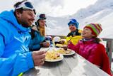 Fototapety Ski - skiers enjoying lunch in winter mountains