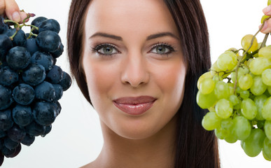 Beautiful woman holding fresh grapes