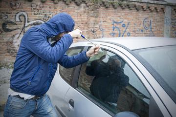 thief stealing car city