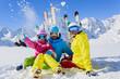 Skiing, skiers, sun and fun - family enjoying winter