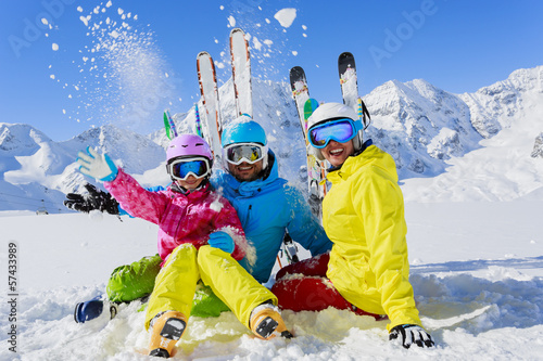 Skiing, skiers, sun and fun - family enjoying winter